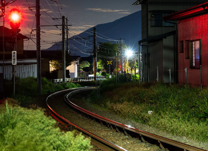 Track Railroad Track Rail Transportation Transportation Architecture Built Structure Building Exterior Illuminated Nature Night Plant Sky No People Mode Of Transportation Electricity  Street Street Light Building Lighting Equipment City Outdoors Power Supply