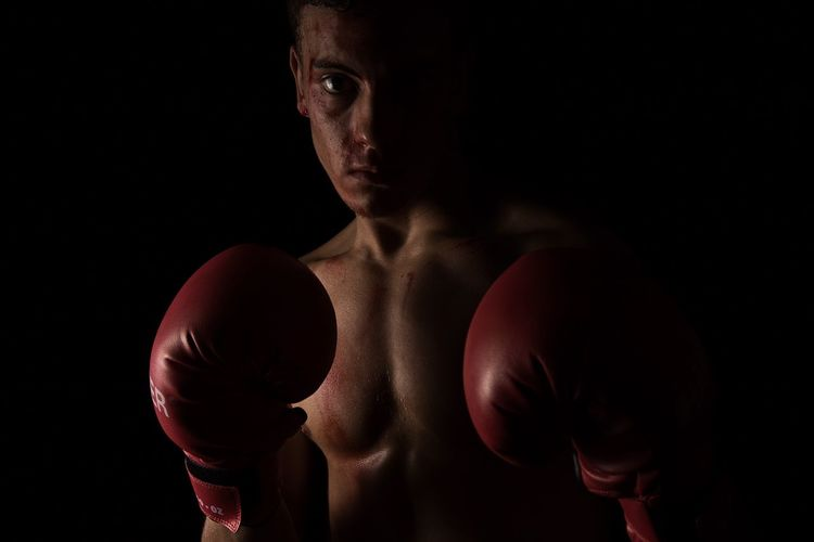 Portrait Of Man Wearing Boxing Gloves