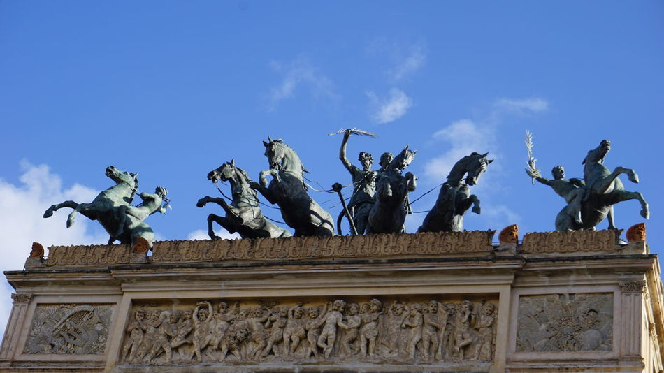 Politeama Theater. Detail of the horses sculptures on the theater's roof. Piazza Politeama, Palermo, Sicily, Italy. Vacations Vacation Streetphotography Blue Sky Blue Palermo Sicily Italy Photo Photographer Sony Sony A6000 Sonyalpha Travel Destinations Travel Architecture_collection Photography Horse Horses Horse Sculpture Politeama Politeama Theatre Palermo Sicilia Italia Architecture Architectural Detail