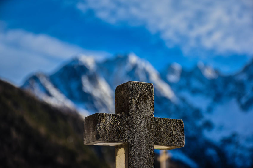 Cross Religion Belief No People Tombstone Grave Focus On Foreground Nature Day Spirituality Blue Cemetery Mountain Sky Outdoors Stone Memorial EyeEmNewHere Eye4photography  EyeEm Nature Lover Taking Photos The Great Outdoors - 2017 EyeEm Awards The Week on EyeEm EyeEm Selects EyeEm Gallery