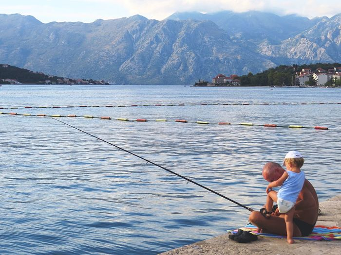 Cutest scene of a grandpa fishing and playing with the grandson Kotor Montenegro Travelingtheworld  Travelphotography People OpenEdit