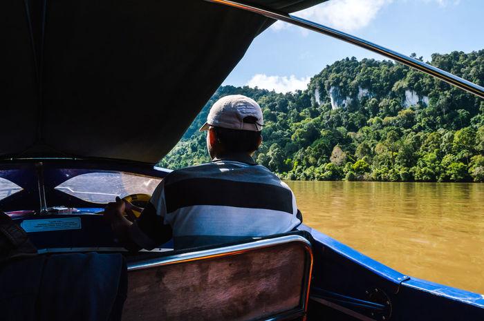 @Kayan River Travel Traveling Adventure Day Karst Karst Formations Lifestyles Men Mode Of Transportation Nature Nautical Vessel Occupation One Person Plant Real People Rear View River Sitting Sky Transportation Tree Water