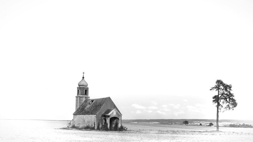 Architecture Beach Beauty In Nature Black And White Black And White Photography Building Exterior Built Structure Church Church Towers Day Nature No People Outdoors Religion Religious Architecture Sea Sky Tranquil Scene Tranquility Tree Tree Vacations Water