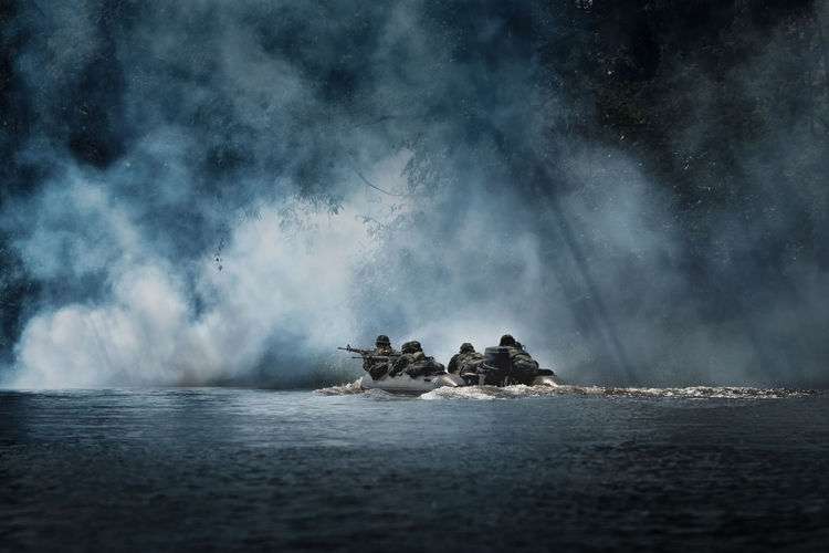 Troops are patrolling on the river Beauty In Nature Day Long Exposure Motion Nature Outdoors Power In Nature Real People Scenics - Nature Sea Sky Smoke - Physical Structure Tranquility Transportation Two People Unrecognizable Person Water Waterfront