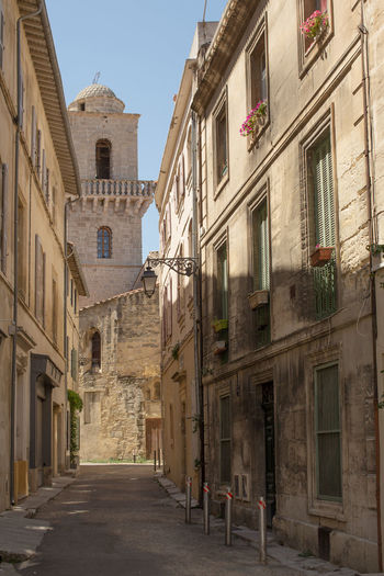 A narrow street at Arles, France Architecture Building Exterior Built Structure City Clear Sky Day Diminishing Perspective Long Narrow No People Old Town Residential District Residential Structure Street The Way Forward Tourism Travel Destinations Window