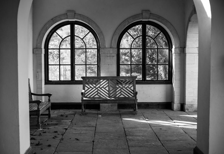 Bodnant gardens in North Wales UK Window Arch Architecture Indoors  Seat Flooring Day Absence No People Empty Building Built Structure Chair Glass - Material Furniture Table Tiled Floor Domestic Room Transparent Bench In Front Of Window Black And White