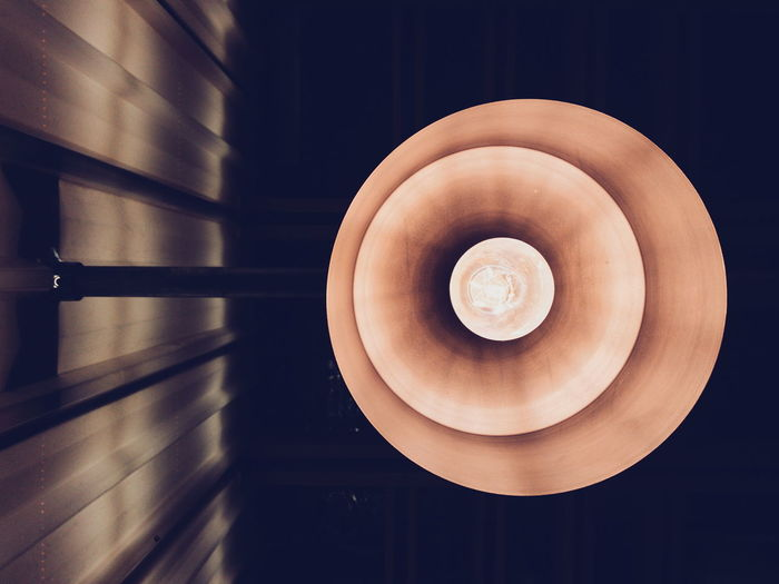 Directly Below Shot Of Pendant Light Hanging From Ceiling