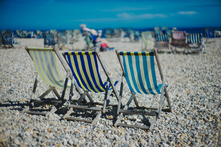 Vacation Calm Deckchairs Holiday Relaxing Travel Beach Blue Sky England Pebbles Summer Sun Three Travel Destinations Uk