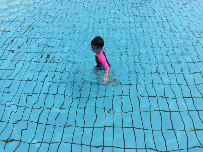 Full Length Of Child In Swimming Pool