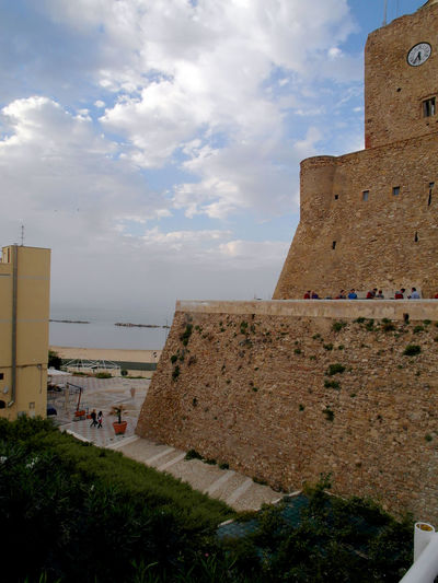 View of the castle of Termoli Termoli  Ancient Ancient Civilization Architecture Beach Building Exterior Built Structure Clock Clock Tower Clouds Clouds And Sky History Italy Molise Outdoors Sea Tower Travel Destination