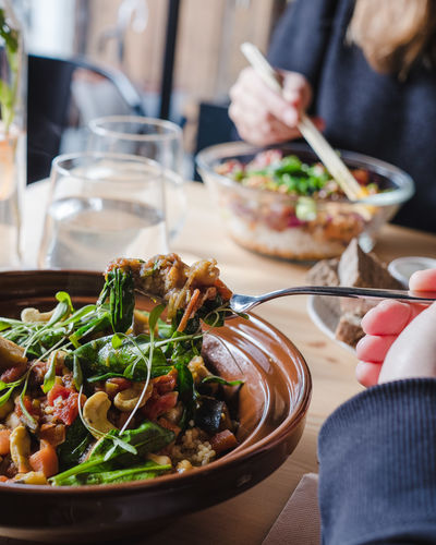 Food And Drink Food Real People Human Hand Freshness Table One Person Ready-to-eat Holding Hand Unrecognizable Person Healthy Eating Human Body Part Lifestyles Plate Focus On Foreground Indoors  Bowl Women Glass Meal Finger