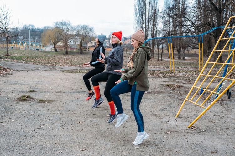 Female friends exercising in park