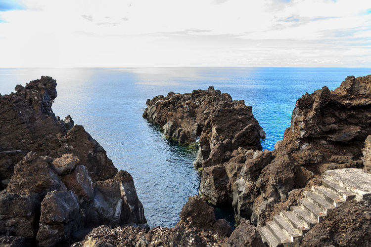 Azores Pico Island Basaltic Rock Beach Beauty In Nature Day Dog Rocks Eroded Horizon Horizon Over Water Land Nature No People Non-urban Scene Outdoors Rock Rock - Object Rock Formation Rocky Coastline Scenics - Nature Sea Sky Solid Tranquil Scene Tranquility Water