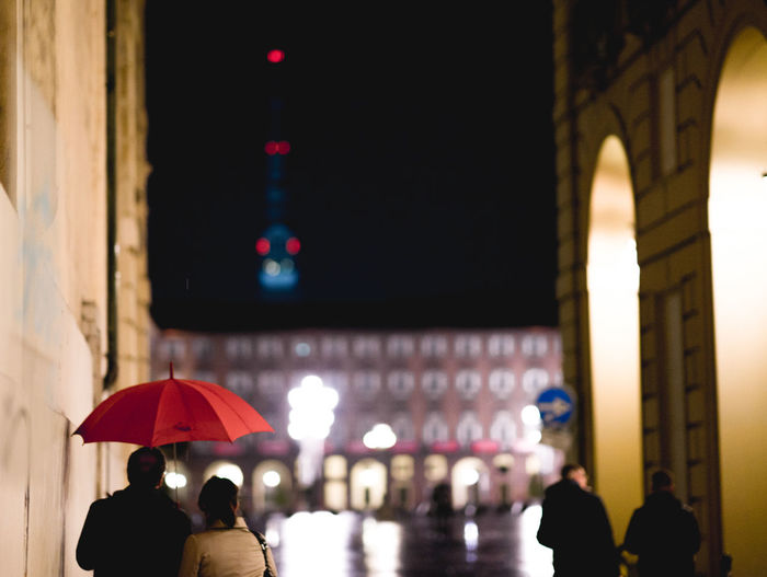 Rainy night in the city of turin Torino Rain Outdoors Security Focus On Foreground Incidental People Lifestyles People City Night Men Building Exterior Illuminated Built Structure Umbrella Protection Group Of People Real People Adult Women Architecture Mirkomacaritorino