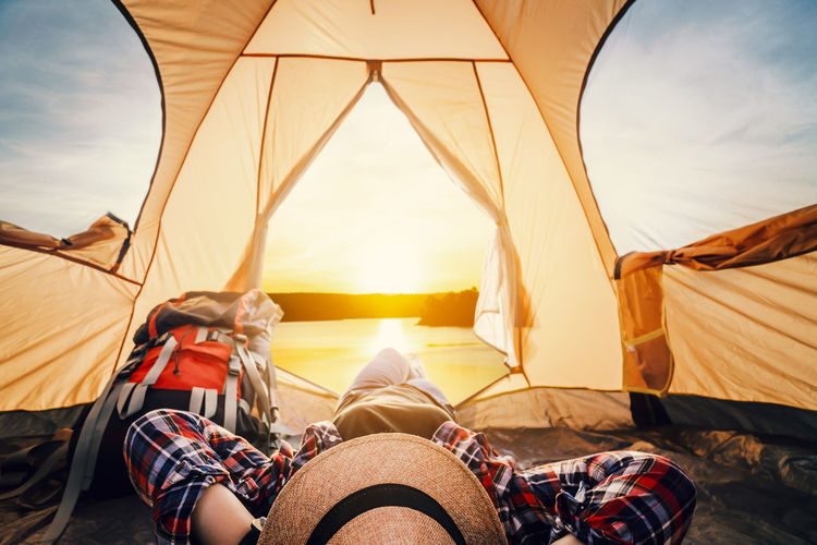 Sky Tent Real People Leisure Activity Nature Sunset Adventure Lifestyles Camping Travel Relaxation Trip Vacations Women Sun