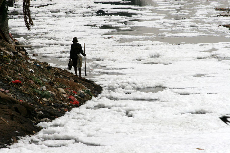 Man walk beside Foam river Bad Condition Pollution In My World Wasted Environment Environmental Issues Foam Garbage Nature Pollution River Unhygienic Water