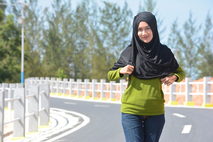 Adult Adults Only Beautiful Woman Day Front View Hijab Hijabstyle  Hood - Clothing Hooded Shirt Leisure Activity Lifestyles One Person One Young Woman Only Outdoors People Portrait Real People Smiling Standing Three Quarter Length Tree Young Adult Young Women Be. Ready.