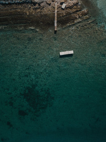 Jetty and pontoon in the sea No People Green Color Day Nature High Angle View Plant Outdoors Built Structure Architecture Grass Land Close-up Wall - Building Feature Tranquility Textured  Wall Growth Still Life