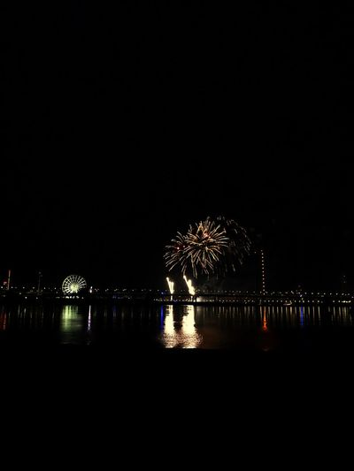 Firework EyeEm Selects Night Illuminated Water Sky Copy Space Celebration Reflection No People Event Waterfront Firework Dark Outdoors City River Glowing
