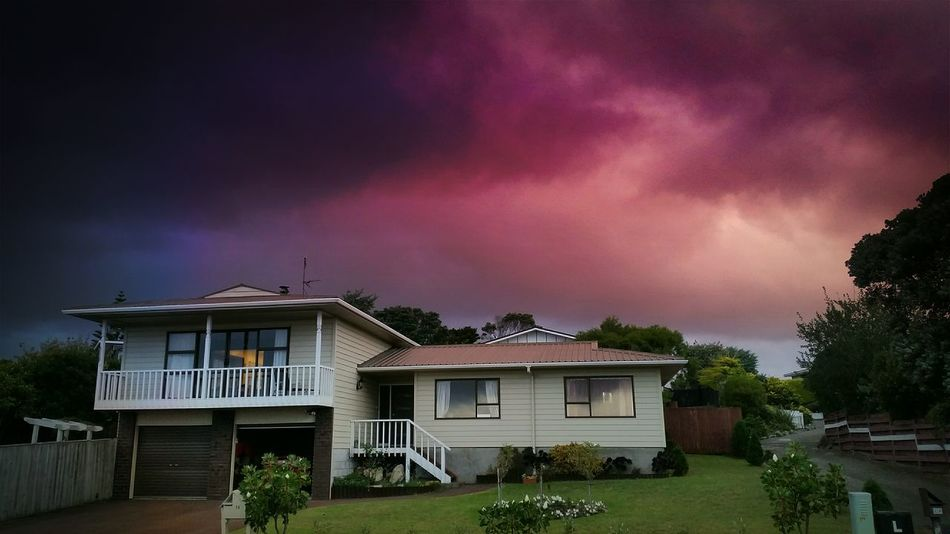 Something brewing in the sky above our house tonight... Purple Clouds Ghostbusters Storm Brewing....