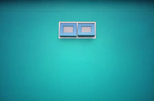Wall - Building Feature Window No People Blue Green Color Copy Space Built Structure Architecture Building Exterior Day Building Full Frame Turquoise Colored Backgrounds Close-up Colored Background House Residential District Electricity  Pattern Blue Background Wall Ventilate Partition Toilet