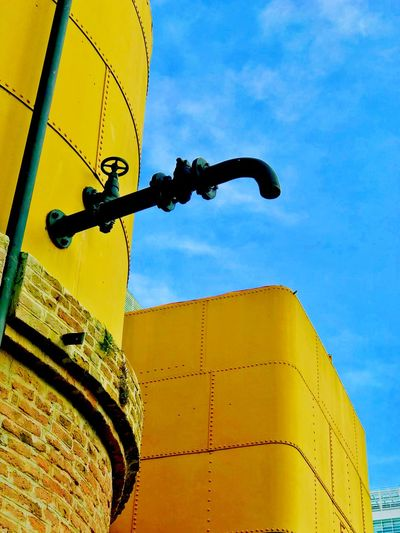 Valve Container Valve Low Angle View Sky Architecture No People Built Structure Building Exterior Nature Day Cloud - Sky Outdoors Metal Building Yellow Old
