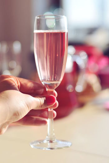 Cheers to Pink October! Glass Human Hand Hand Alcohol Refreshment Drink Holding Focus On Foreground Wine Food And Drink Wineglass Close-up Adult Indoors  Red Celebration Champagne Red Wine Luxury Pink Color Pink Woman Hand Cheers Celebration Event PinkOctober