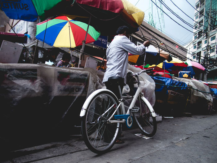 Bicycle owner Multi Colored Outdoors City Street Bicycle Transportation Adult Real People Market EyeEm Best Shots Place Of Heart Live For The Story Eyeem Philippines The Photojournalist - 2017 EyeEm Awards The Street Photographer - 2017 EyeEm Awards Manila Carriedo Olympus OLYMPUS PEN E-P3