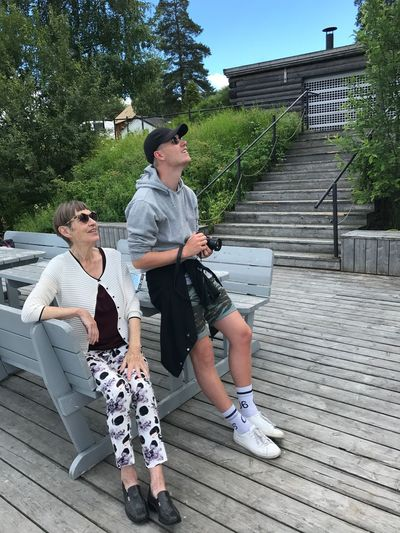 Grandma with grandson EyeEm Selects Full Length Real People Sitting Lifestyles Plant Leisure Activity Casual Clothing Tree Day Seat Architecture Women Togetherness People Nature Bench Females Two People Men Young Adult