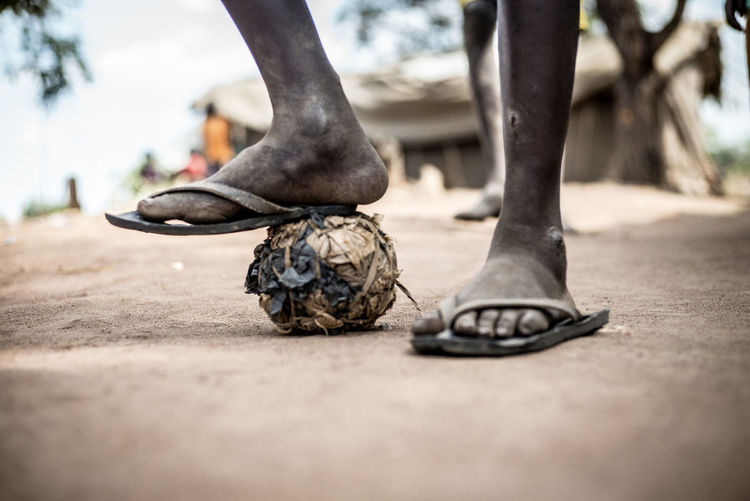 Reportage Documentary No Gadget Uganda  Africa Makeshift Football Makeshift Ball Selfmade Soccer Ball Sustainable Lifestyle Sustainable Resources Toys Out Of Junk African Sport Soccer In Poor Countries African Soccer Village Soccer Village Life Rubbish Ball African Football Soccer Ball Human Foot Human Body Part Selective Focus Improvised Ball My Best Photo
