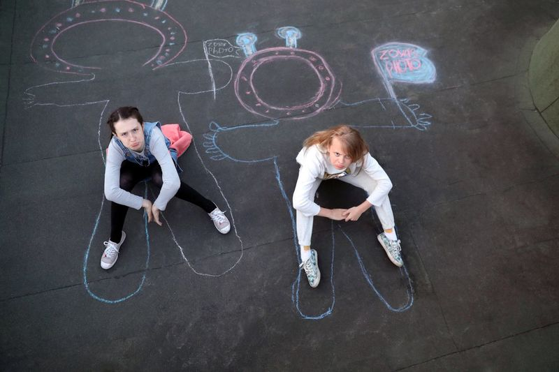 """Stopping """"Planet Earth"""" In The Roof Drawings On Asphalt Children Playing Aliens Drawing Childhood Offspring Creativity Full Length Girls Board Togetherness Two People Chalk - Art Equipment Blackboard  People Females Chalk Drawing"""