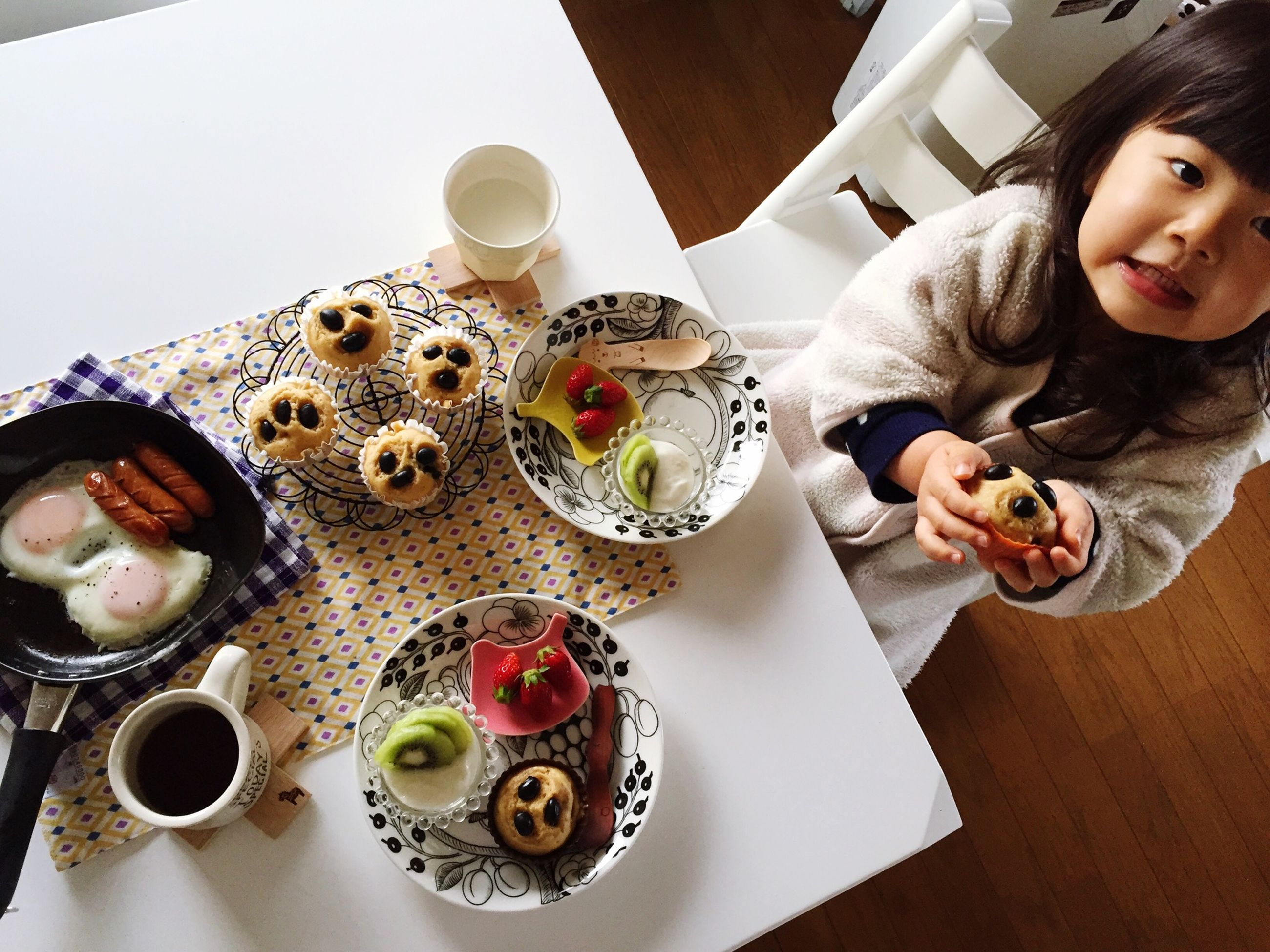 indoors, food and drink, plate, table, food, drink, lifestyles, leisure activity, freshness, refreshment, sweet food, high angle view, person, dessert, ready-to-eat, holding, indulgence, childhood