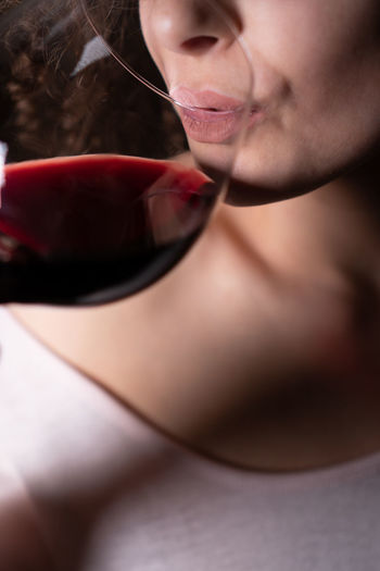 Wine, Drink Female Alcohol Red Wine Drinking Drunk Alcoholic  Young Adult Young Women Non Recognizable People Close-up Party Celebration Concept Sommelier Tasting Lips Beautiful Gastronomy Restaurant Pub Celebrate No Face Wine Glass Wine Holding Copy Space Background Sober  Drunkenness Friday Night