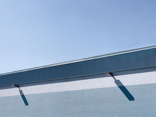 The Architect - 2018 EyeEm Awards EyeEm Selects Day Clear Sky Copy Space Low Angle View Built Structure No People Architecture Blue Sky Building Exterior Lines Wall Industrial Warehouse Minimalism Minimal Minimalobsession Shadow Backgrounds