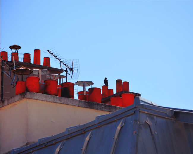 Low angle view of red containers on building