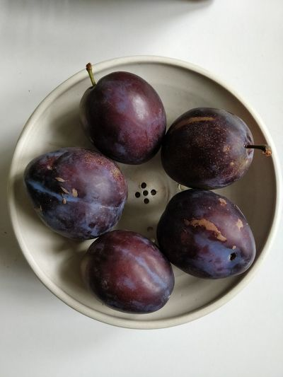 High angle view of grapes in plate