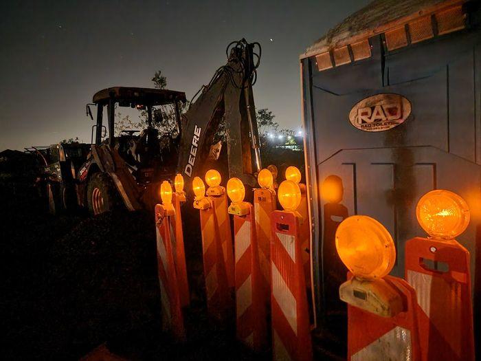 Illuminated lanterns against sky at night