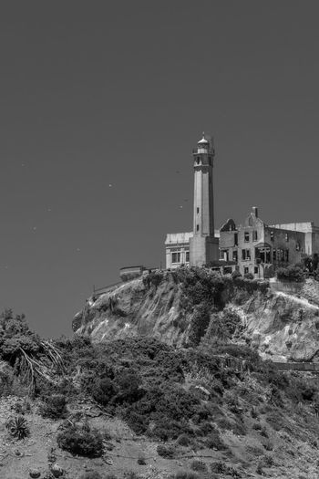 Alcatraz Blackandwhite Built Structure Architecture Building Exterior Sky Building Nature Tower No People Land History Copy Space The Past Clear Sky Plant Lighthouse Low Angle View Night Outdoors Factory
