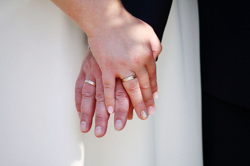 Midsection of woman hands on wall