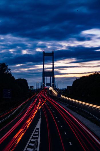 Light trails on highway at dusk