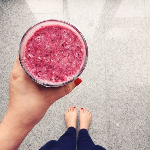 Personal perspective of woman holding smoothie