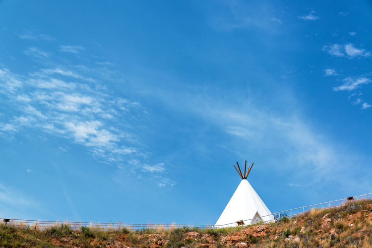 White teepee with a beautiful blue sky near Beulah, Wyoming Beulah Blue Blue Sky Buffalo Jump Sky Teepee Tepee Tipi USA Vore Buffalo Jump White Wyoming