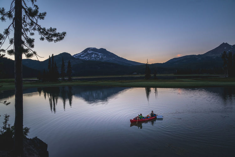Beautiful Sparks Lake in Central Oregon sunrise tranquility serenity Bend Oregon Landscape_Collection Oregon Beauty In Nature Lake Landscape Landscape_photography Leisure Activity Men Mountain Mountain Range Nature Nautical Vessel Non-urban Scene Outdoors Outdoors Photograpghy  Real People Reflection Scenics - Nature Sky Snowcapped Mountain Sparks Lake Sunset Tranquil Scene Tranquility Two People Water Waterfront