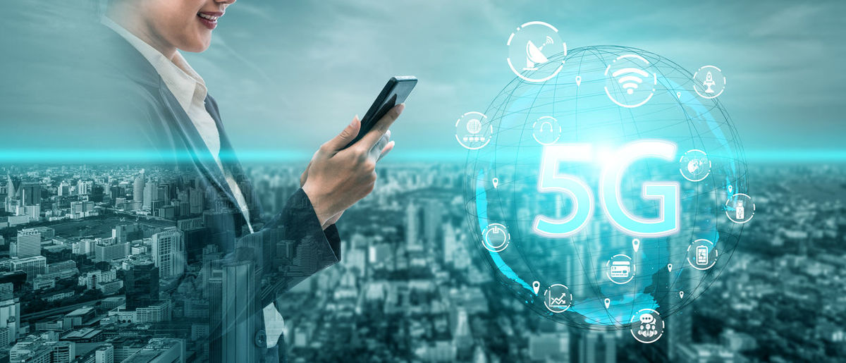 Digital composite image of man holding smart phone