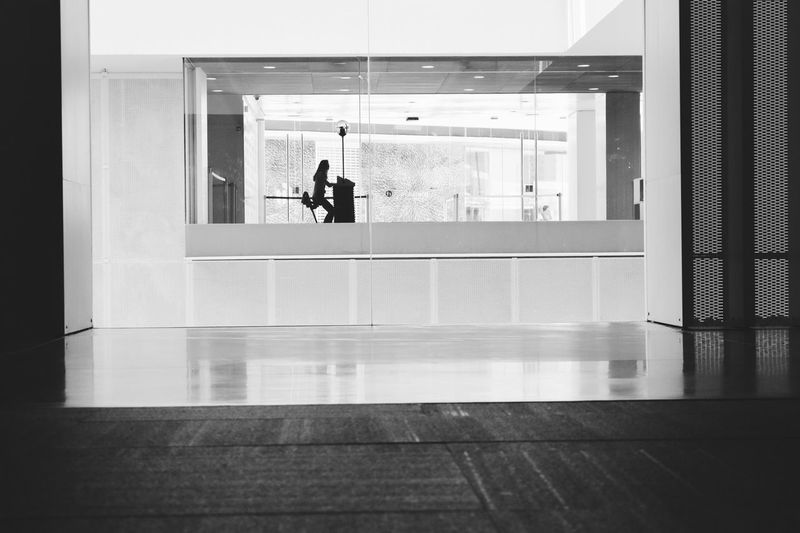 Silhouette Black And White Museum Architecture Indoors  Real People Built Structure Men Reflection Window Glass - Material One Person Day Full Length Entrance Flooring