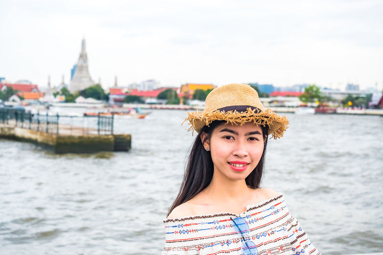 Asian  Beautiful Holiday Pagoda Sightseeing Thailand Travel Woman Attractions Female Happiness Hat Landmark People Picture Portrait Real People Relax Religion Smile Temple Tourism Vacation Woman Portrait Young Women