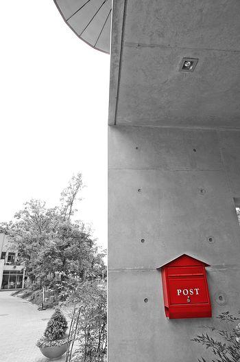 Red umbrella against built structure
