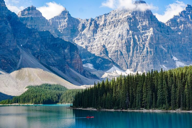 Canoeing through Moraine Lake in Banff National Park. Alberta Beauty In Nature Canada Day Lake Mountain Mountain Range Nature No People Outdoors Reflection Scenics Sky Tranquil Scene Tranquility Tree Water
