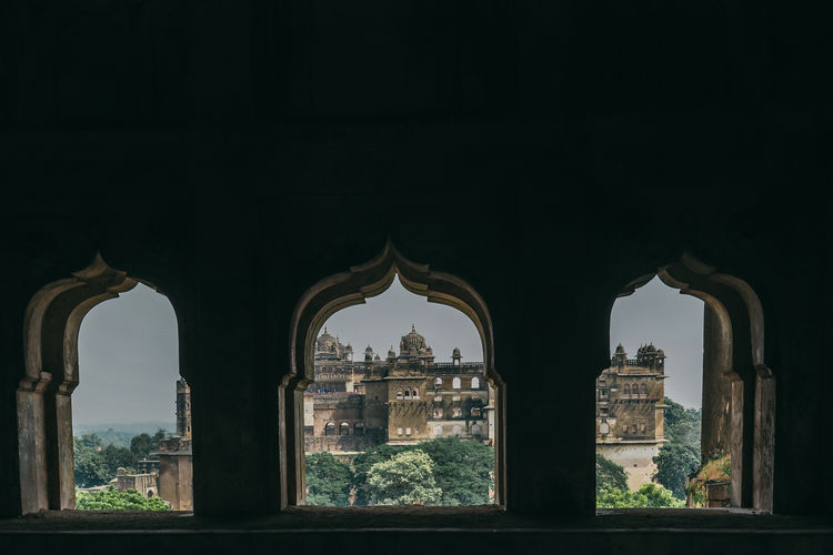 Buildings seen through arch window