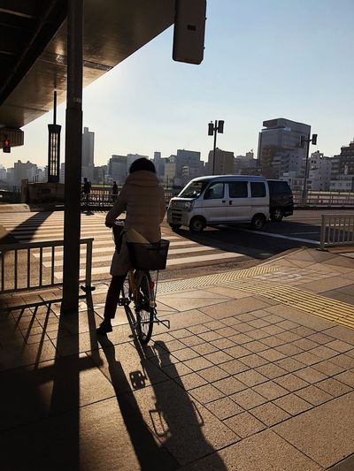 Golden days in Tokyo People Transportation Car Real People Land Vehicle One Person City Shadow Sunlight Street Architecture Day